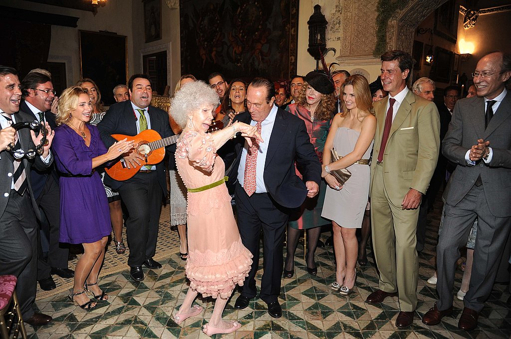 The Duchess of Alba dances flamenco with bullfighter Curro Romero.