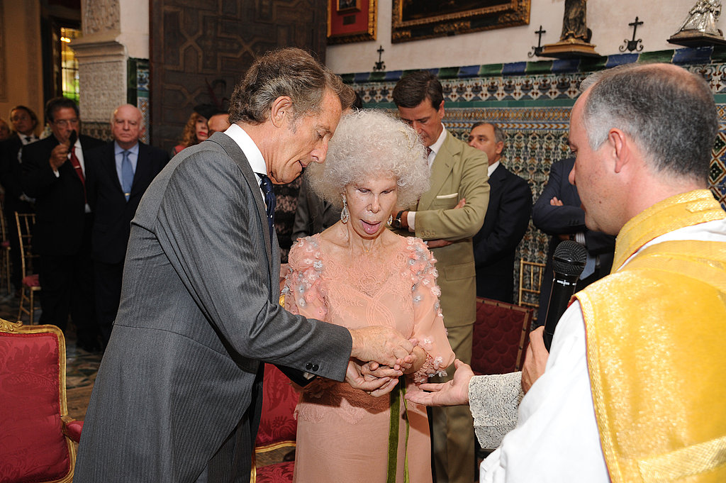 The Duchess of Alba and Alfonso stand during their wedding ceremony.