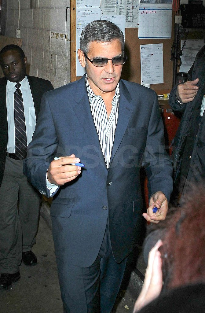 George Clooney stopped to greet fans.