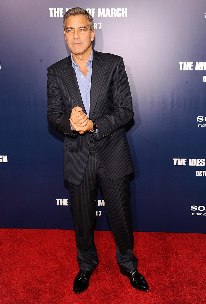 George Clooney pleased photographers by posing at the premiere of The Ides of March in NYC.