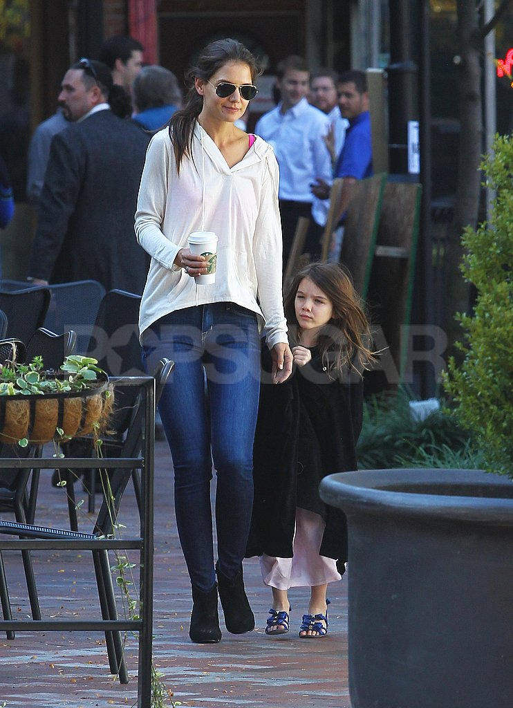 Suri Cruise reached for Katie Holmes's hand in Pittsburg.