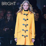 Why we love it: What's not to love about a beautiful, bright coat to embolden your look? Paul & Joe's citrus toggle coat would be a sight for sore eyes in the gray, dead of Winter. How to wear it: Don't over think it — just add a great bright option over your day-to-day wear for a playfully chic finish. Just be mindful of choosing a color that works with your complexion.  Shop the runway: Paul & Joe Monaco Coat ($895)