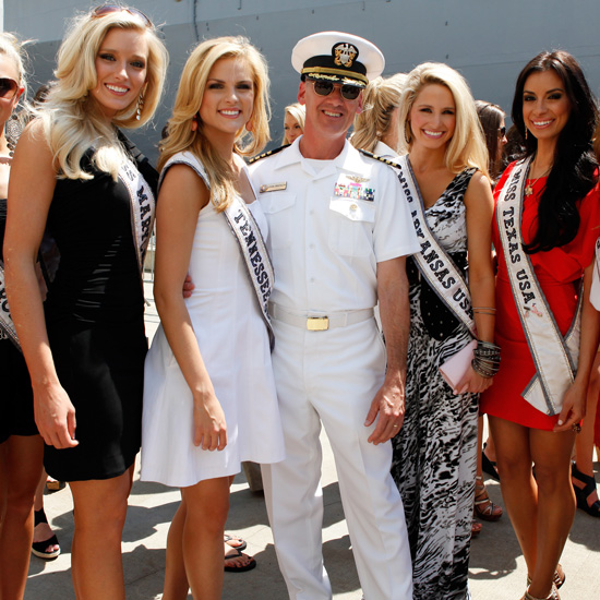 Miss USA contestants posed with an officer during this year's festivities in NYC.