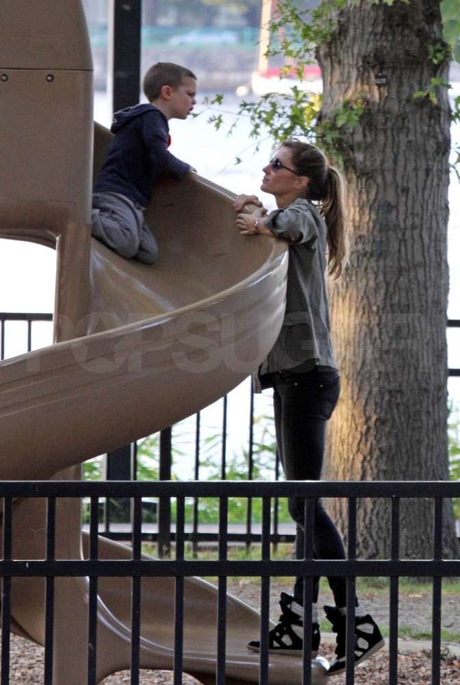 Jack Brady and Gisele Bundchen chatted on a slide.