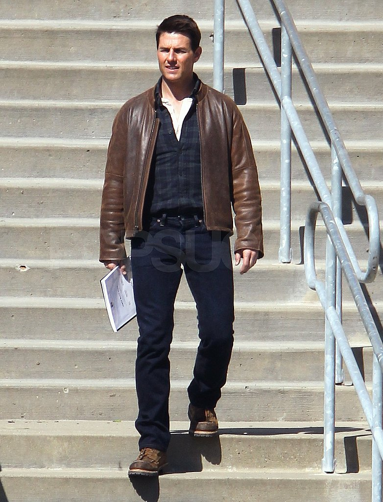 Tom Cruise headed down a long set of stairs on the Pittsburgh set of One Shot.
