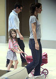 Suri Cruise pushed a pram with Tom Cruise and Katie Holmes.