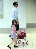 Suri Cruise went for a walk with her dad, Tom Cruise.