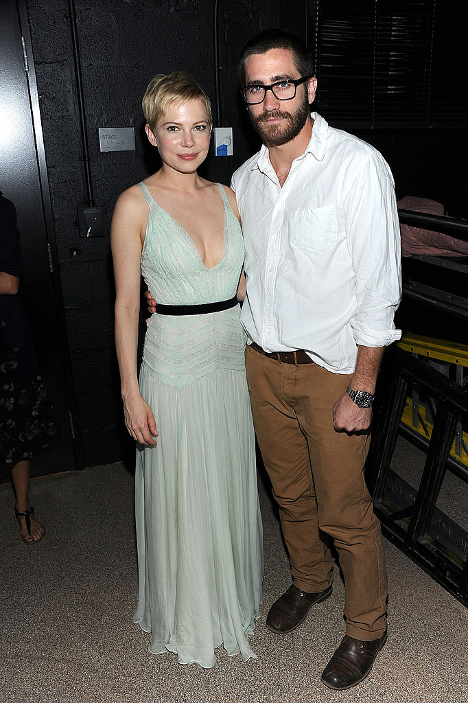 Jake Gyllenhaal put his arm around Michelle Williams.