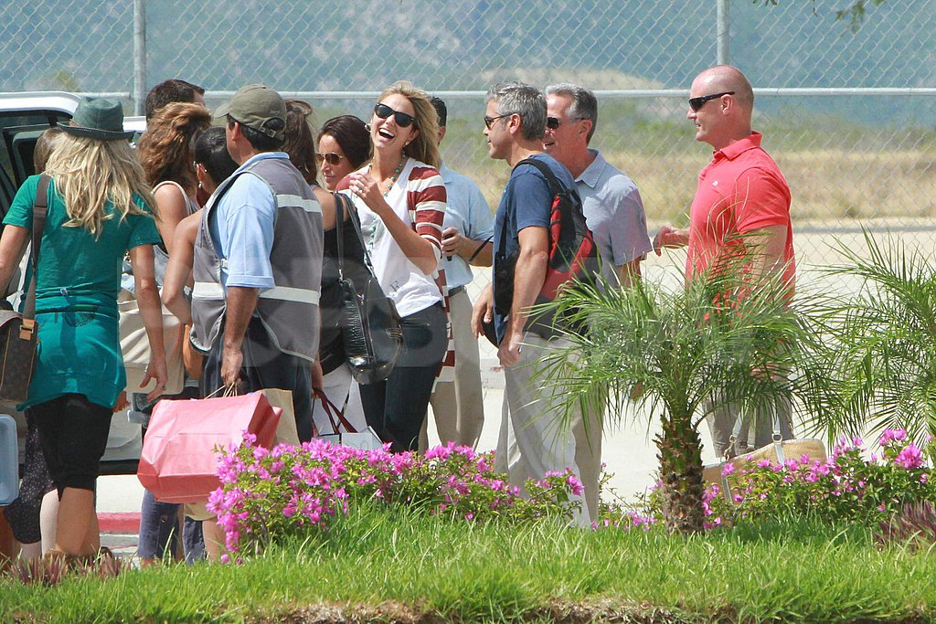 George Clooney and Stacy Keibler at an airport in Mexico.