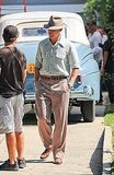 Ryan Gosling in a hat on the set of The Gangster Squad.