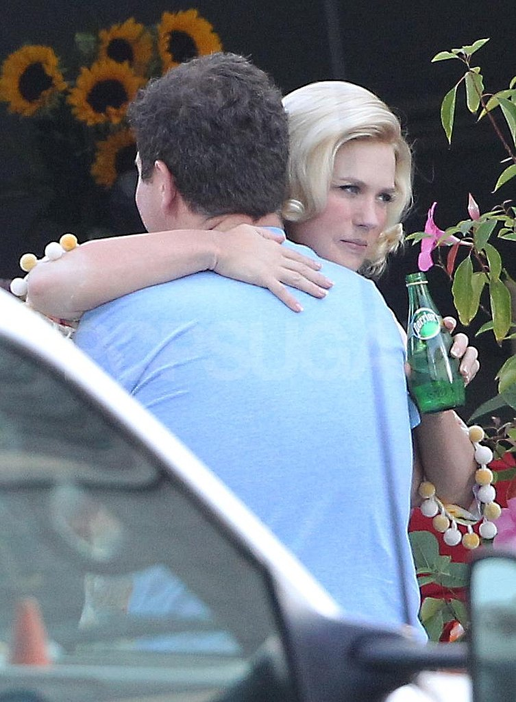 January Jones gave a hug to a friend.