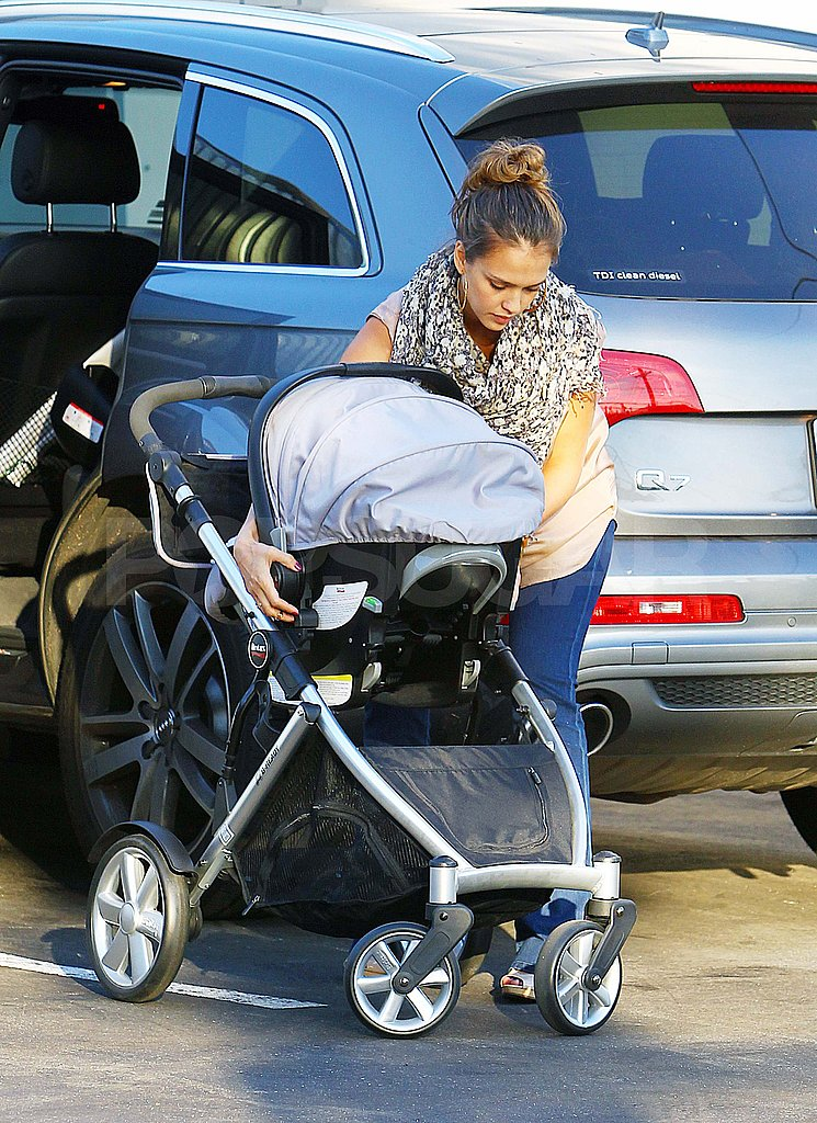 Jessica Alba loads Haven into the car.
