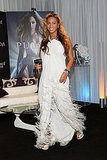 Beyoncé looked almost ethereal in a feathered white Lanvin gown while promoting her new fragrance.