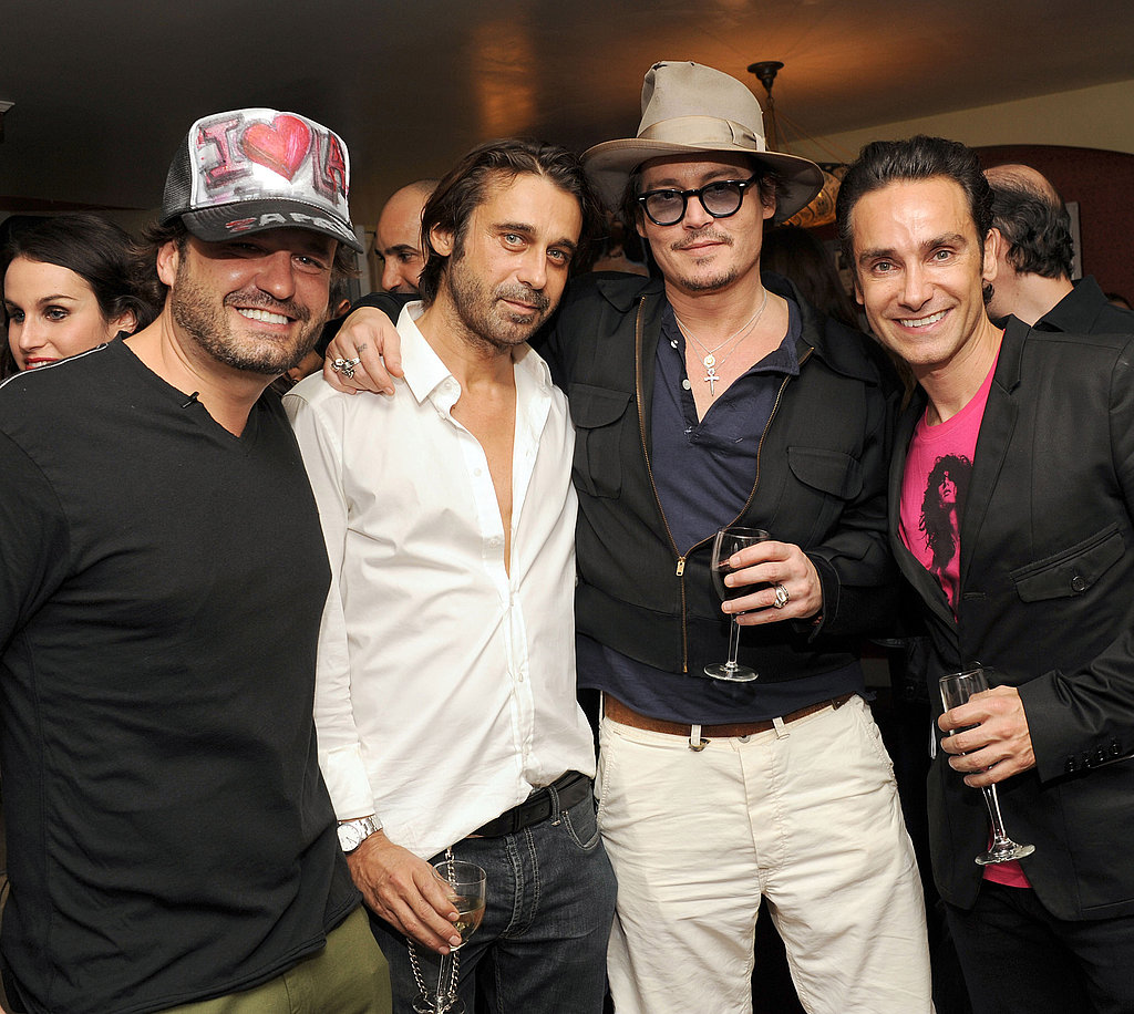 Johnny Depp posed with artists Domingo Zapata, Jorid Molla, and Antonio Del Prete in LA.