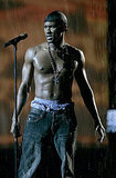 Usher rehearsed for the 2004 VMAs sans shirt and with fake rain falling in the background.