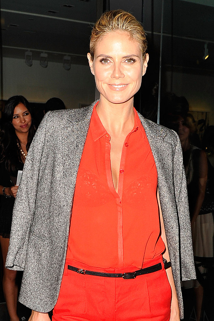 Heidi Klum threw a jacket over her shoulders.