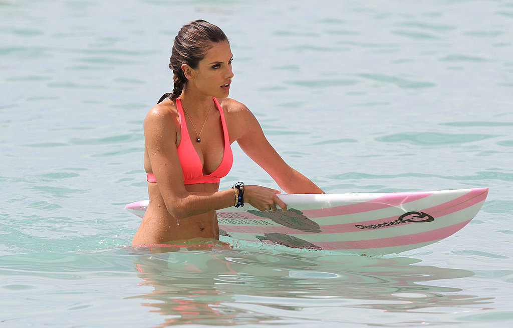 Alessandra Ambrosio with a surfboard in Hawaii.
