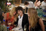 Sienna Miller, Ronnie Wood, and Lily Donaldson shared a laugh.