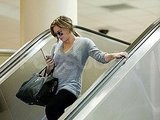 Hilary Duff arrived at LAX showing off her baby bump.