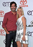 Newlyweds Amy Smart and Carter Oosterhouse stuck close on the green carpet.
