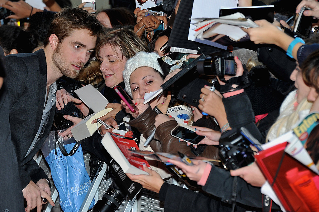 Robert Pattinson with fans in Paris.
