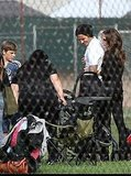 David and Victoria Beckham with Harper at a soccer game in LA.
