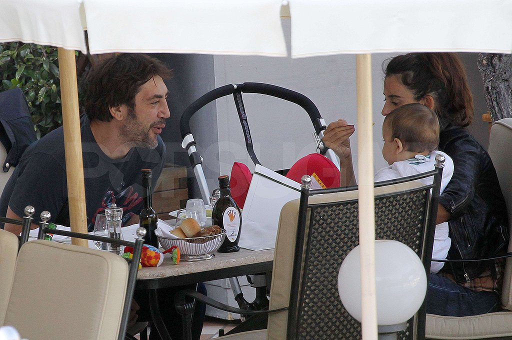 Penelope Cruz and Javier Bardem took turns holding Leo Bardem.