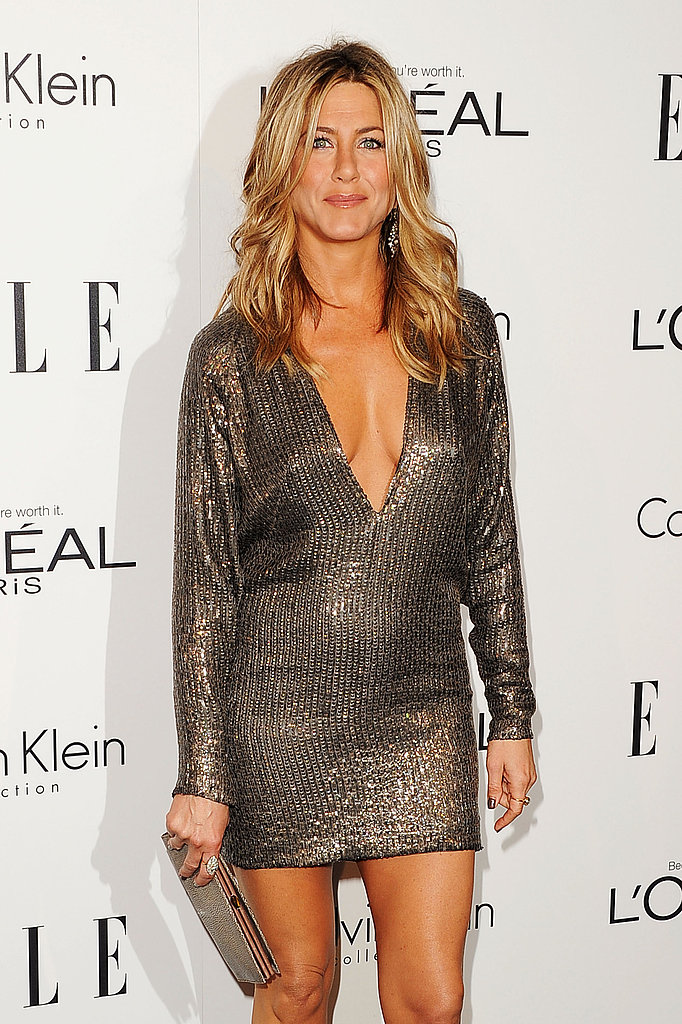 Jennifer Aniston carried a slim clutch to an event in LA.