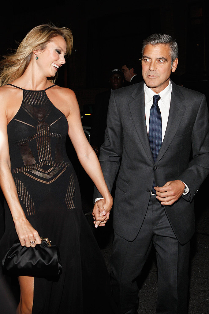 Stacy Keibler smiled on the arm of George Clooney at The Descendants premiere in NYC.