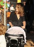 Jessica Alba pushes Haven at the pumpkin patch.