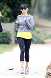 Reese Witherspoon jogs with a friend in LA.