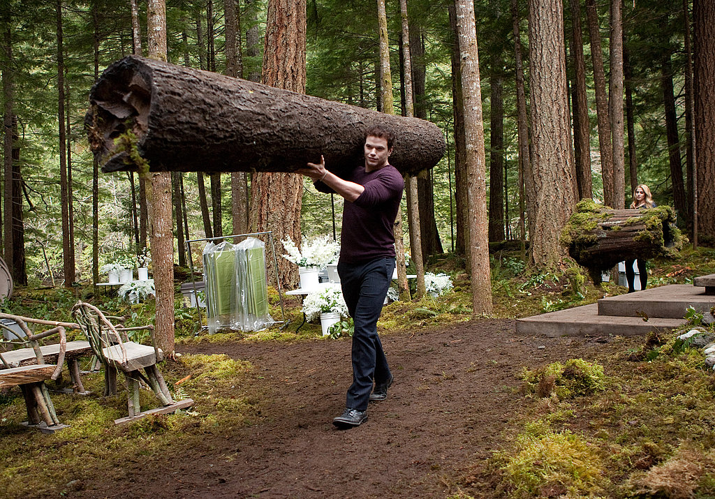 Kellan Lutz carries a log like it's no big deal in Breaking Dawn Part I.