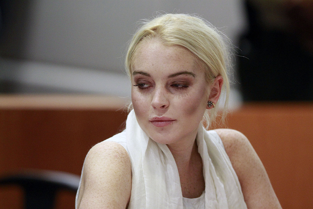 Lindsay Lohan watched her attorney.