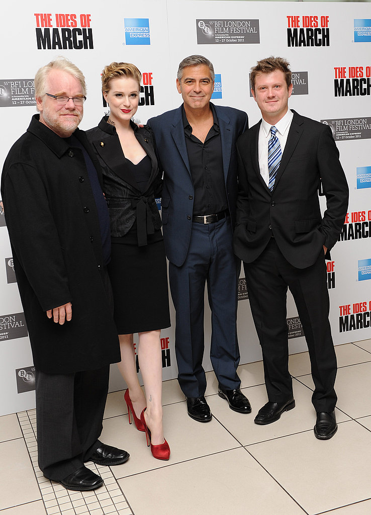 George Clooney, Philip Seymour Hoffman, and Evan Rachel Wood pose together in London.