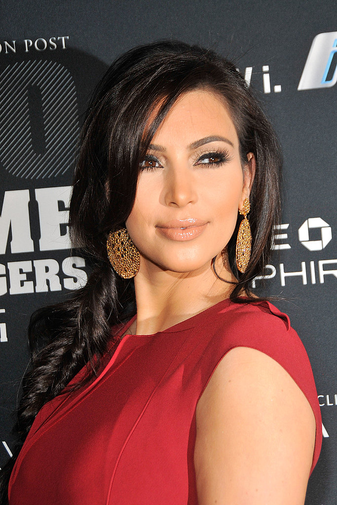 Kim Kardashian posed for pictures before picking up her honor.