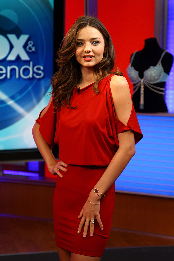 Miranda Kerr wore a sexy red dress to kick off her day.