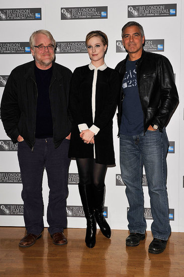 George Clooney, Philip Seymour Hoffman, and Evan Rachel Wood at a press event in London.