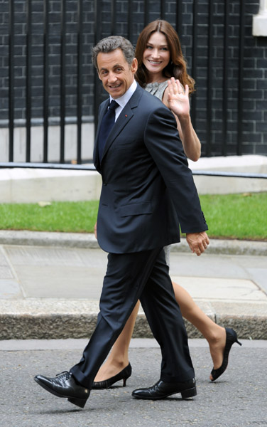 The Sarkozys are all smiles arriving at Downing Street in London last year.