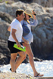 A pregnant Carla Bruni takes a walk with her husband in the south of France this past Summer.