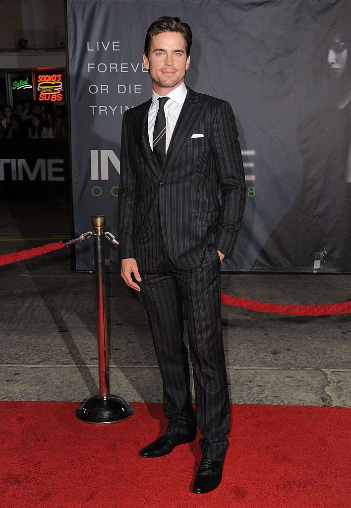 Matt Bomer in a pinstriped suit.