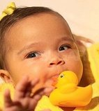 Monroe is adorable with her rubber ducky.