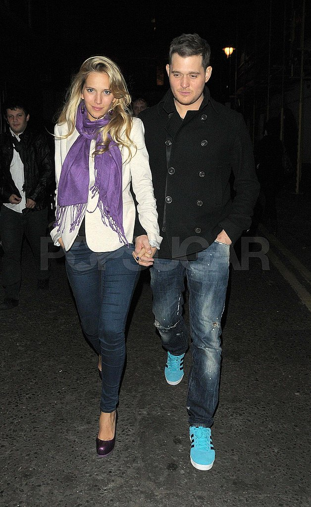 Michael Bublé and Luisana Lopilato walking in London.