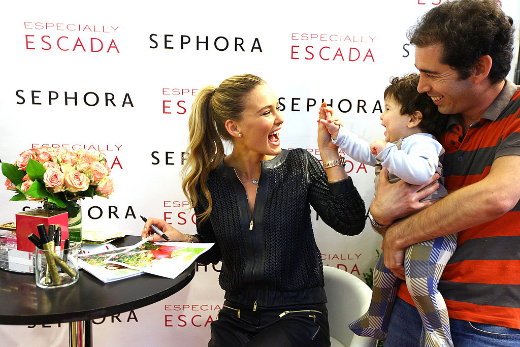 Bar Refaeli met a baby in NYC.
