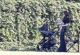 Victoria Beckham in the shade with Harper.