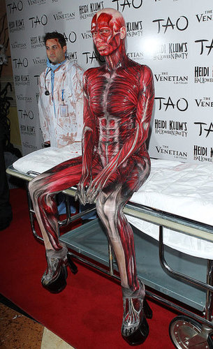 "Heidi Klum rolled into her 2011 Las Vegas party in an anatomically correct ""Visible Woman"" costume."