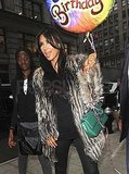 Kim Kardashian carried a birthday balloon.