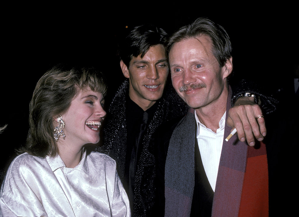 Julia Roberts laughed even while sporting heavy eyeshadow and a feathered haircut at a movie premiere with brother Eric and actor Jon Voight.