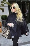Jessica Simpson holding her stomach in NYC.
