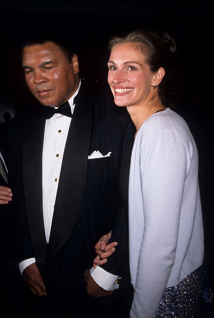Julia Roberts smiled with Muhammad Ali at an Amnesty International party in 1998.