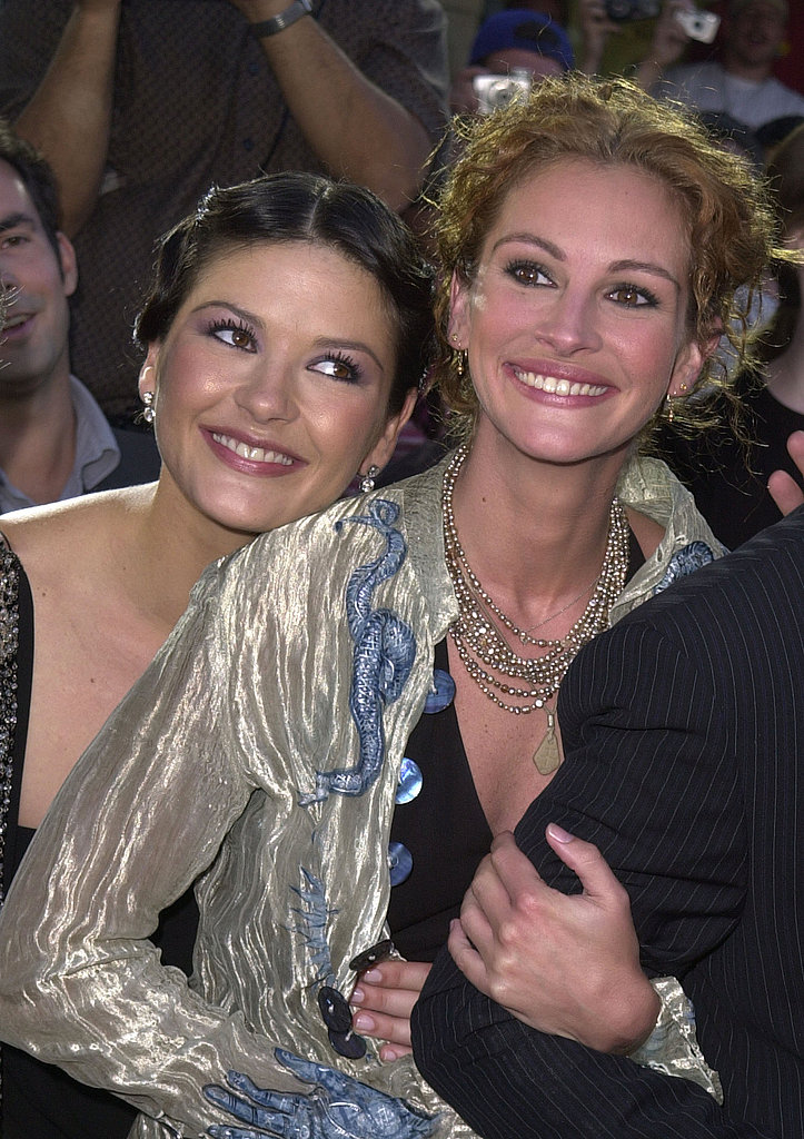 Catherine Zeta-Jones squeezed into a photo with Julia Roberts while at an America's Sweethearts premiere in 2001.